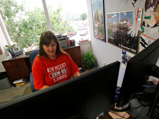 Catherine Walker Grobler, a student recruitment specialist for the University of New Mexico, works in her office on Tuesday at the UNM San Juan Center in Farmington.