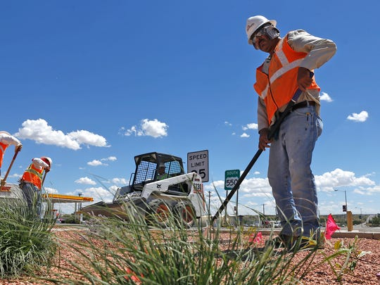 From left, David Green, Juan Pando and Armando Diaz, construction laborers with The GroundsKeepers, work last year on a median landscape project Aug. 4 in Bloomfield. City officials hope the beautification project draws more business to the city.