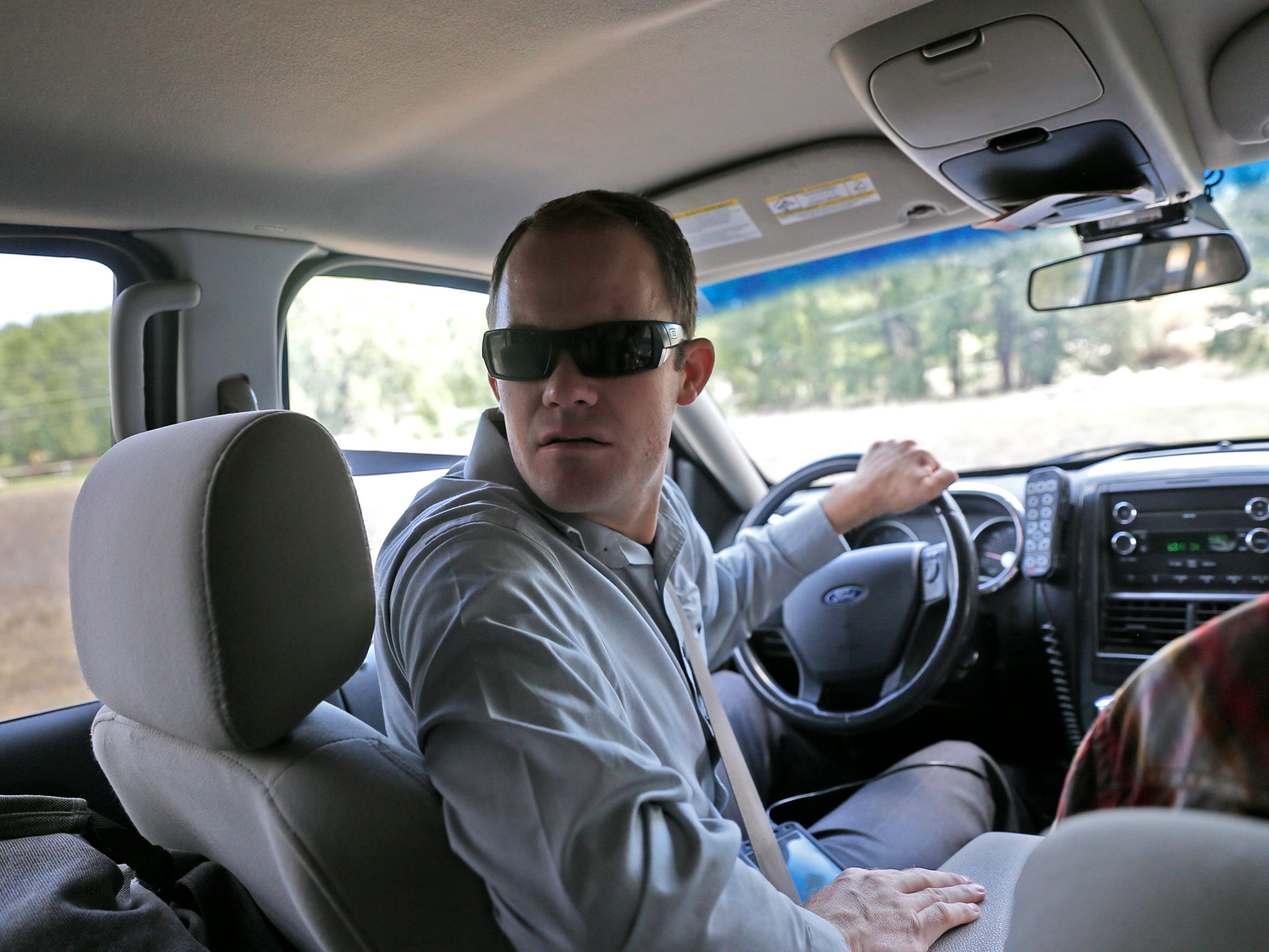 San Juan County Sheriff's Office Detective Andrew Gilbert drives during a patrol on Tuesday in Bloomfield.