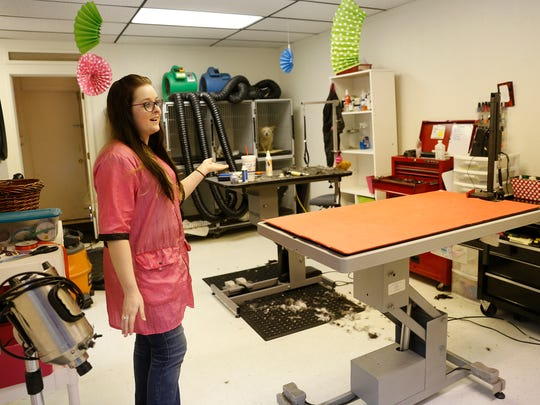 Scissors and Sudzs Pet Salon owner Britani Warner gives a tour of her salon on Monday at Scissors and Sudzs Pet Salon in Farmington.