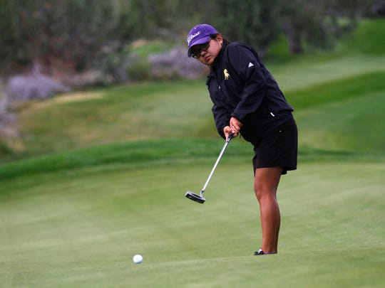 Kirtland Central's Tiger Tsosie putts during the PV Invitational on Monday at Piñon Hills Golf Course in Farmington.