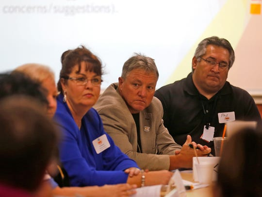 Bloomfield Schools Superintendent Kim Mizell, left, San Juan County Chief Executive Officer Kim Carpenter and Farmington Municipal School's Deputy Superintendent Phil Valdez listen during Friday's meeting at San Juan College's School of Energy in Farmington.