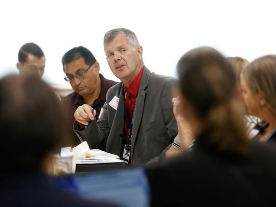 Farmington Municipal Schools Superintendent Eugene Schmidt, center, speaks during a meeting presented by New Mexico First and the New Mexico State Education Department Friday at San Juan College's School of Energy in Farmington.