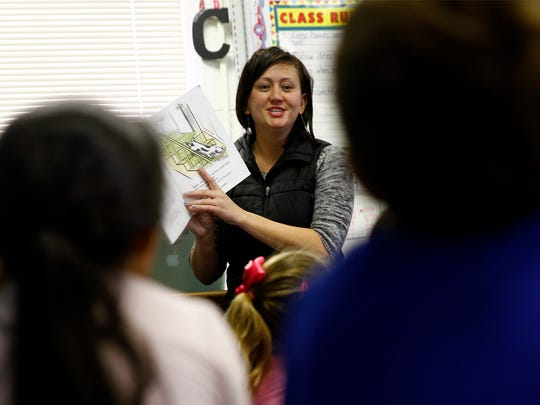 Bluffview Elementary School kindergarten teacher Grace Coleman reads to her class on Jan. 5, 2015. San Juan County school districts are bracing for cuts in state funding if Gov. Susana Martinez signs Senate Bill 9 into law.