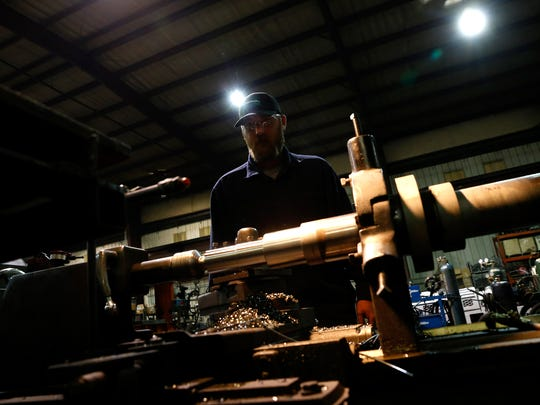Mining Equipment Inc., machinist Cameron Jones works on Nov. 3 inside the machine shop in Farmington.