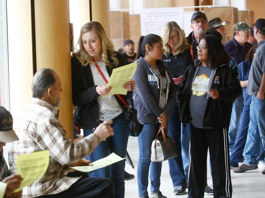 Voters line up to cast their ballots Friday at the Farmington Museum at Gateway Park.