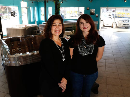 From left, Sunset Spas owner Lynn Howell and her daughter, Lexi Howell, pose for a photo on Monday at the new family business.