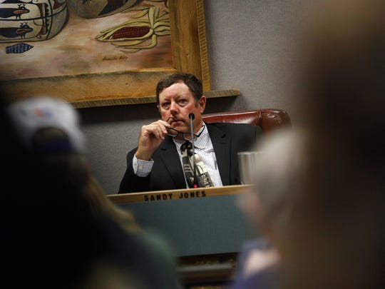 Sandy Jones, the District 5 commissioner with the New Mexico Public Regulation Commission, listens to testimony from AV Water Co. customers on Oct. 12 at the San Juan County Administration Building in Aztec.