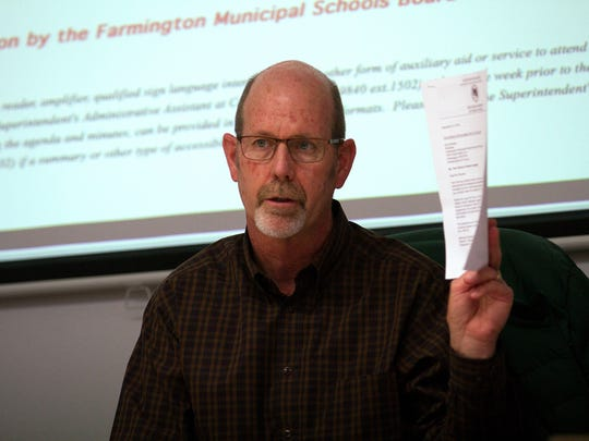 Kyle Rhodes, president of the Farmington Municipal School District board, speaks Friday during a special board meeting at district's central office.