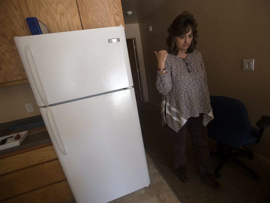 Jonna Sharpe, executive director of People Assisting the Homeless, on Tuesday talks about their family housing units in one of PATH's  apartments in Farmington.