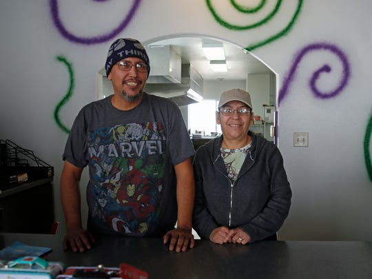 Munchies owners Ernest and JoAnn Roybal pose at the counter of their new sandwich shop in Farmington on Thursday, Jan. 26, 2017.