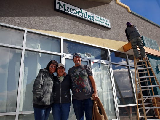 Jessica Godinez, JoAnn Roybal and Ernest Roybal pose in front of their new sandwich shop on Thursday, Jan. 26, 2017. The Roybals and their daughter, Godinez, own and manage the restaurant at 5150 College Blvd., Suite 206.