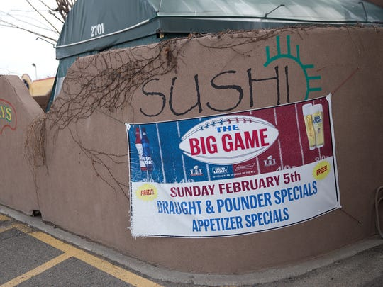 A banner promotes a Super Bowl Party at Clancy's Pub and Irish Cantina in Farmington on Friday.