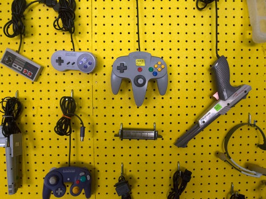 Gaming controllers are displayed Friday at Oldskool Gaming in Farmington.