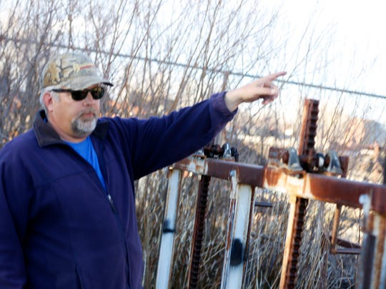 Andrew Dean, the board chairman of the Bloomfield Irrigation District, talks Tuesday about the ditch that provides water to the Harvest Gold subdivision east of Bloomfield.