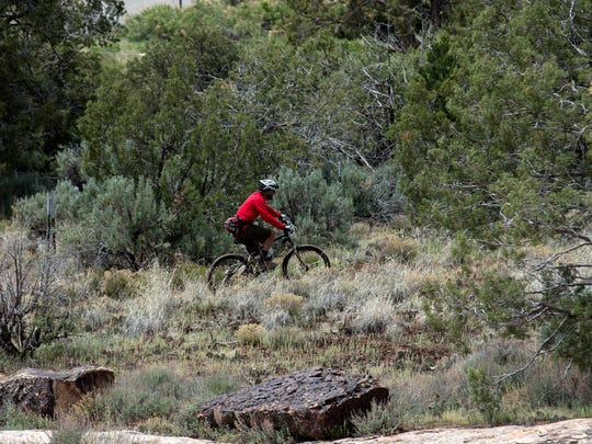 Marc Smith of Durango, Colo., rides near the Sand Canyon trailhead at the Canyons of the Ancients National Monument near Cortez, Colo.