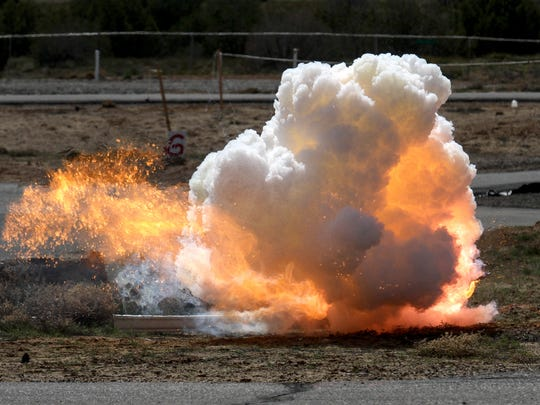 One of the dozen explosions members of the Bureau of Alcohol, Tobacco, Firearms and Explosives set off as part of a training session for local law enforcement officials.