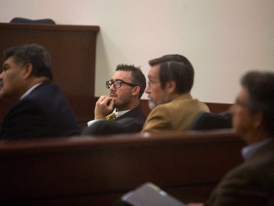 Bloomfield City Attorney Ryan Lane, center, and Bloomfield City Manager Eric Strahl, right, listen to arguments during a hearing Wednesday in Aztec District Court.