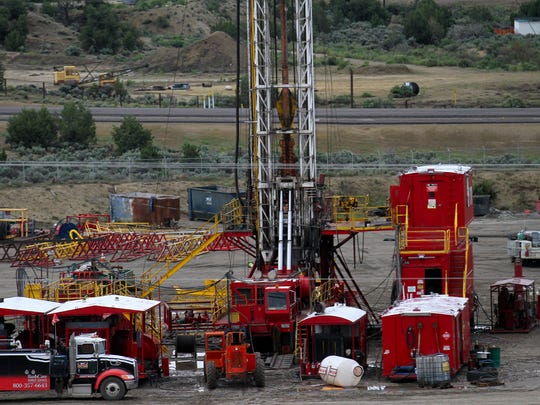 A drilling rig is pictured earlier this month at Aztec Well Service in Aztec.