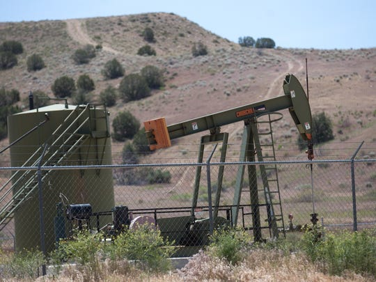 A pumpjack operates in Farmington. State sales of oil and gas leases on state lands are skyrocketing, a direct contrast to activity in San Juan County on federally-controlled lands.