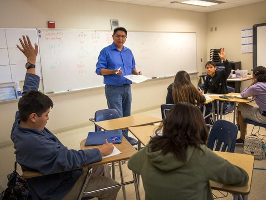Henry Fowler, a math professor at Diné College, leads an exercise Thursday during a mathematics camp at Navajo Preparatory School in Farmington.