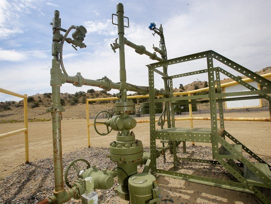 A ConocoPhillips oil and gas well in Aztec is pictured