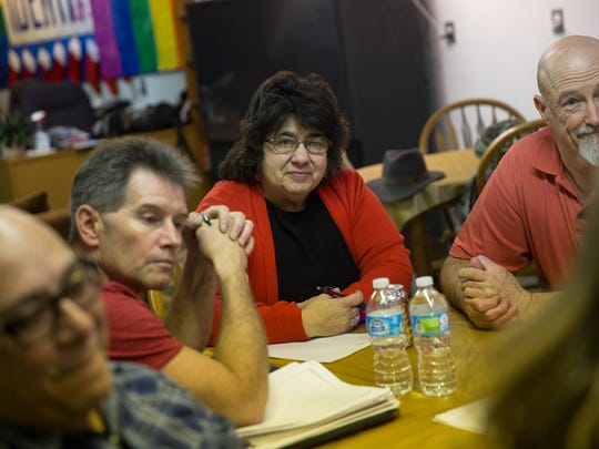 From left, Community member Joe Rivas, Identity Inc., board member James Penrod, In this file photo, Identity Inc. President Judy Palier and community member Mark Lewis attend a bi-weekly community meeting, Wednesday, Jan. 4, 2016, lead by Palier at Identity Inc., in Farmington.