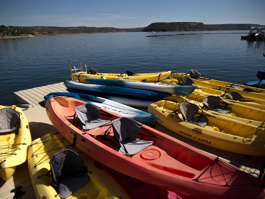 Rental kayaks are stacked, Thursday, June 8, 2017 at the Navajo Lake Marina at Navajo Dam.