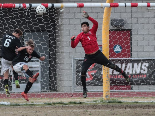 Palm Springs keeper Kevin Corella stops a goal attempt by Ayala in the first half on Wednesday, February 14, 2018.