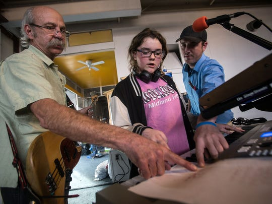 Jim Kuzma, left, Amber Swinney and Michael Stephens of the Imagine Band review a song during rehearsal on Feb. 6, 2017, in Aztec.