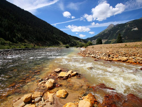 Cement Creek, right, merges with the Animas River Aug. 10, 2015, in Silverton, Colo., in the aftermath of the Gold King Mine  spill.