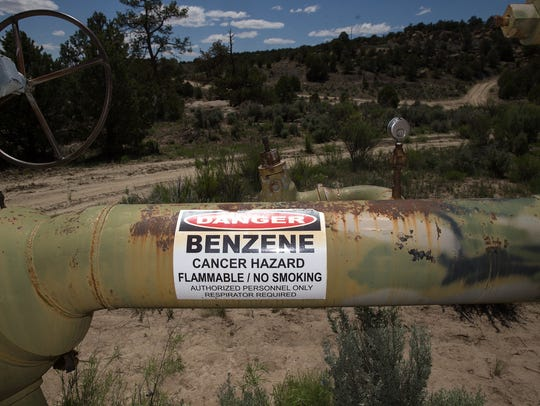 A caution sign is visible at an oil and gas site May 15, 2017, at the Devil's Spring Ranch in Gobernador.