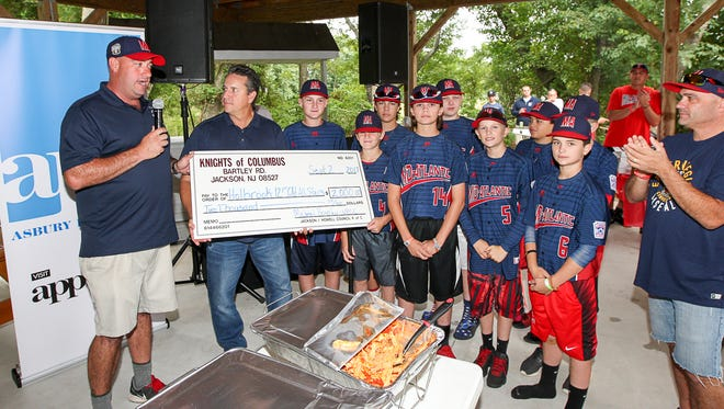 Holbrook Little League officials accept a $2,000 check from the Knights of Columbus at a celebration party for the Holbrook Little League team at the Kights of Columbus in Jackson sponsored by the APP, Knights of Columbus and Mona Lisa's Pizza on September 2, 2017.
