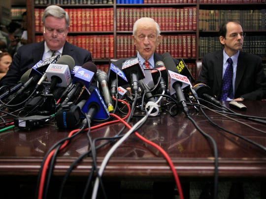 Manhattan District Attorney Robert Morgenthau, center, speaks to reporters during a news conference, Friday, Oct. 2, 2009 in New York.