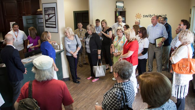 Executive Director Carol Hollowell leads local and state officials on a tour through the Switchpoint Community Resource Center Thursday, April 7, 2016.