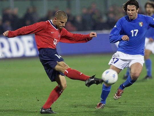 U.S. midfielder Chris Armas, left, fights for the ball