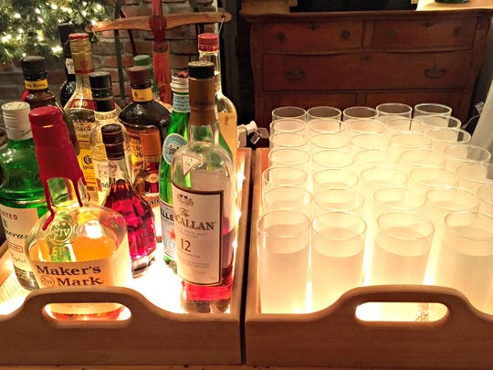 Guests won't mind pouring their own drinks at this lighted bar station.