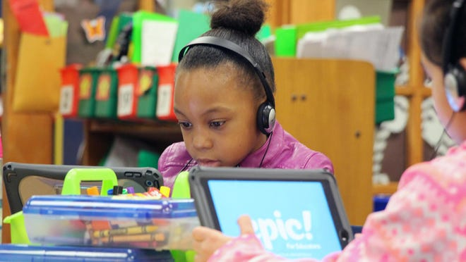 First-graders at Broken Arrow Elementary in the Shawnee Mission school district learn reading.