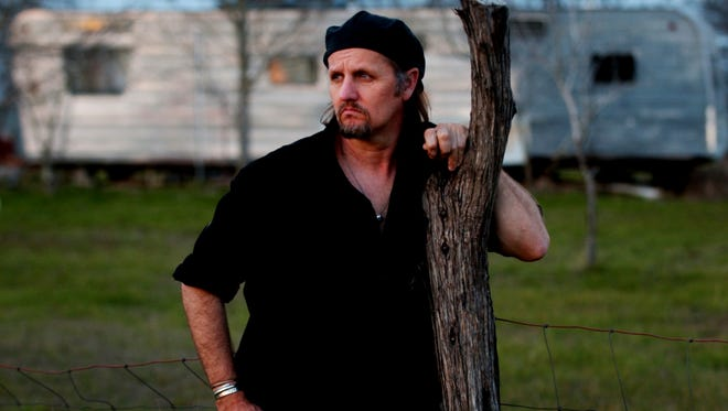 In this Feb. 15, 2005, photo, singer-songwriter Jimmy LaFave poses for a portrait in Austin