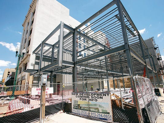 VICTOR CALZADA-EL PASO TIMES A two-story, 12,000 square-foot office and retail building is being constructed next door to the Martin Building as part of the Downtown building renovation project.