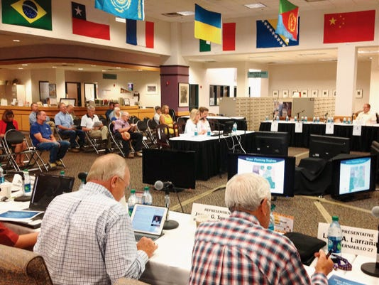 Deborah Dixon, director of the Interstate Stream Commission, and Eileen Dodds, secretary/treasurer of the New Mexico Water Dialogue, discuss the state's regional water plans on Tuesday in Silver City. Randal Seyler - Sun-News