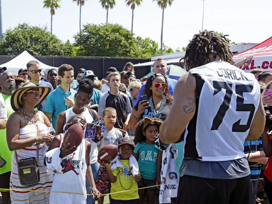 Lebanon's Jared Odrick draws a crowd of autograph seekers during the Jaguars' minicamp in June. Odrick signed a 5-year, 42.5 million contract with Jacksonville in March.