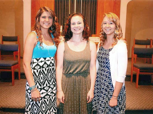 Chairperson of the Joanne Grossnickle Scholarship Committee Naomi McClelland, center, congratulates scholarship recipients Cathleen Doody, left, and Beth Reed, right. Jessica Plunkard and Sarah Jewell, who were also chosen as scholarship recipients, were absent for the photo.