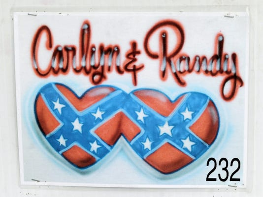 A Confederate flag design on display at a booth offering airbrushed T-shirts and license plates at the York Fair. Out of the thousands of designs, only two contain the design. The owners said they'd take down the items, if asked.