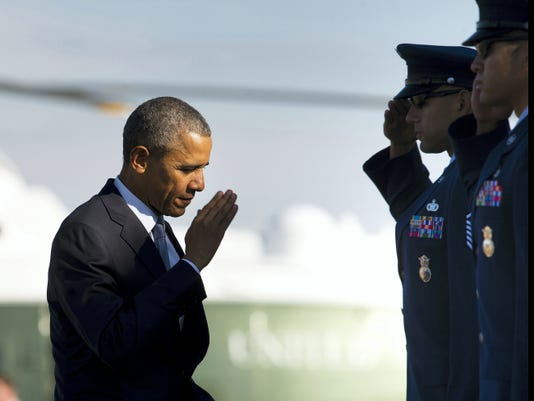 FILE - In this Friday, Oct. 9, 2015, file photo, President Barack Obama returns a salute prior to boarding Air Force One before his departure from Andrews Air Force Base, Md. Obama will keep 5,500 U.S. troops in Afghanistan when he leaves office in 2017, according to senior administration officials, casting aside his promise to end the war on his watch and instead ensuring he hands the conflict off to his successor. (AP Photo/Pablo Martinez Monsivais, File)