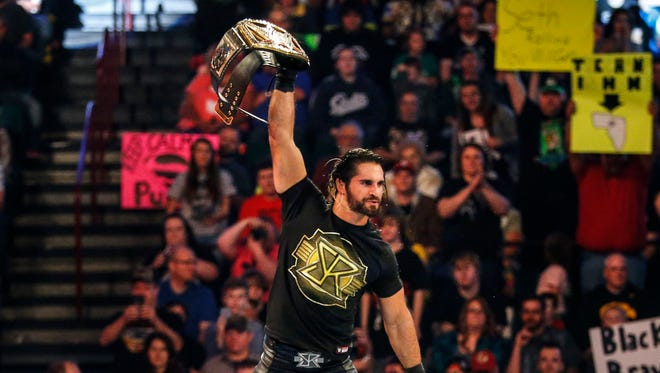 WWE Champion and Davenport native Seth Rollins climbs into the ring in Moline, Ill. Tuesday, April 28, 2015.