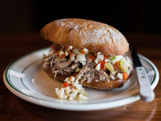The porchetta sandwich is one of the featured dishes