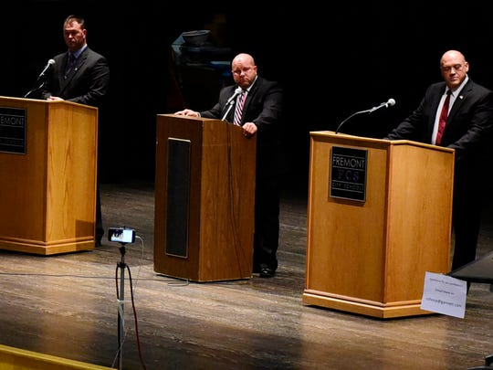 David Yonke, editor of The News-Messenger and News Herald, moderates the Sandusky County sheriff candidates' debate among independent challenger Chris Hilton, from left, incumbent Republican Sheriff Kyle Overmyer and independent challenger James Consolo on Thursday night.