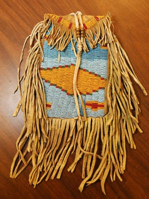 A beaded bag, an Out of the Attic item is shown March 11 at the Des Moines County Heritage Center Museum in Burlington.