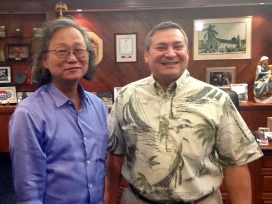 Founder of the Japan Medical Marijuana Association Koichi Maeda takes a photo with Gov. Eddie Calvo after a meeting on Jan. 31 to discuss medical marijuana for Japanese patients.